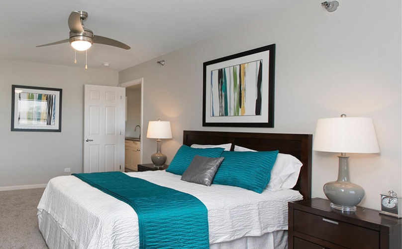 Bedroom has overhead light and fan